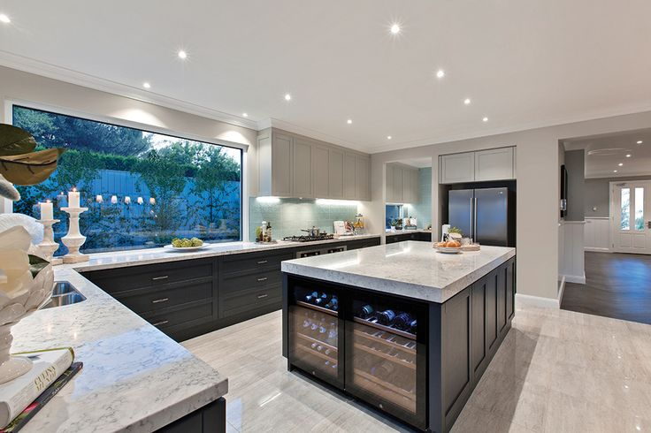 Open plan kitchen with wine fridge in the Astor Grange with Classic Hamptons World of Style.