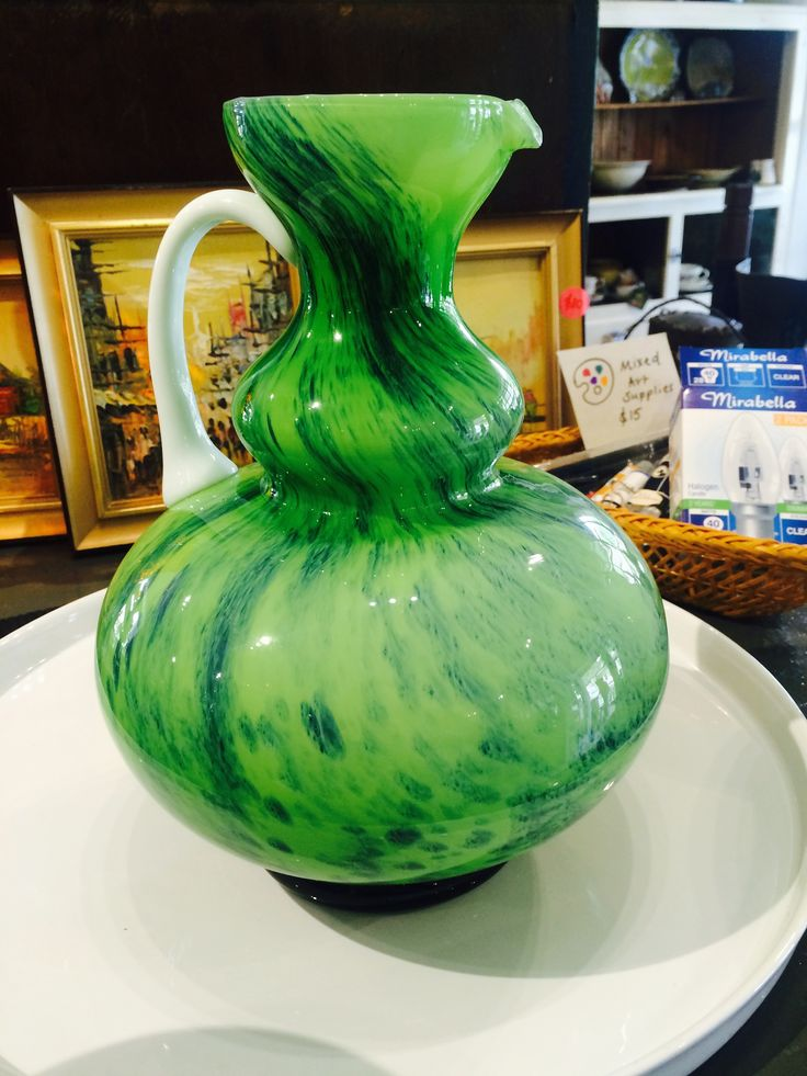 Stunning green glass jug, in perfect condition.  Currently on shop floor.  for more details vist our website or Facebook page https://www.facebook.com/Whatever-at-Willunga-118129198383581/timeline/!