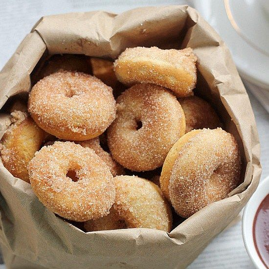 A simple recipe for baked mini cinnamon sugar donuts. Light and fluffy mini cake donuts tossed in cinnamon sugar. This recipe can be used with a mini donut pan or with a mini donut maker! …