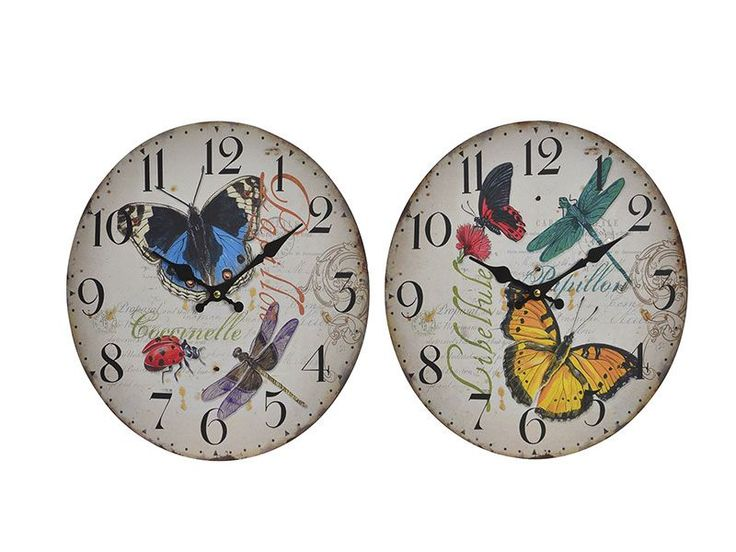 #reloj de pared #mariposa y #pajaro por tan solo 6 € en catay home https://www.catayhome.es/categoria/relojes/