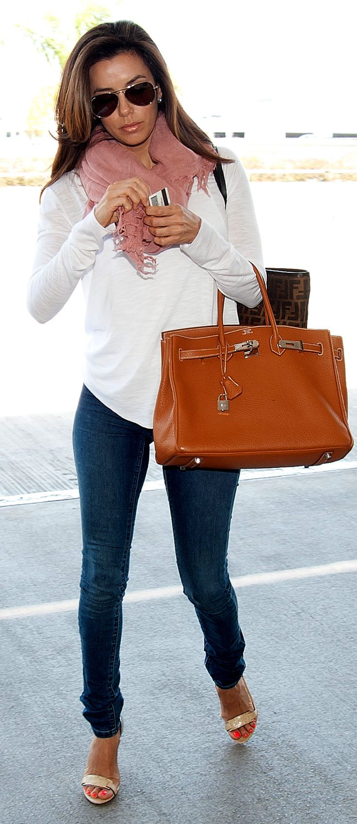 Eva Longoria arrives at JFK Airport in NYC.  April 5, 2012. Casual