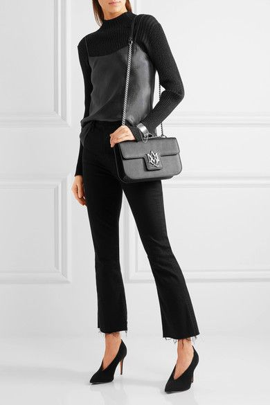 Black textured-leather (Calf) Snap-fastening front flap Comes with dust bag Weighs approximately 1.5lbs/ 0.7kg Made in Italy