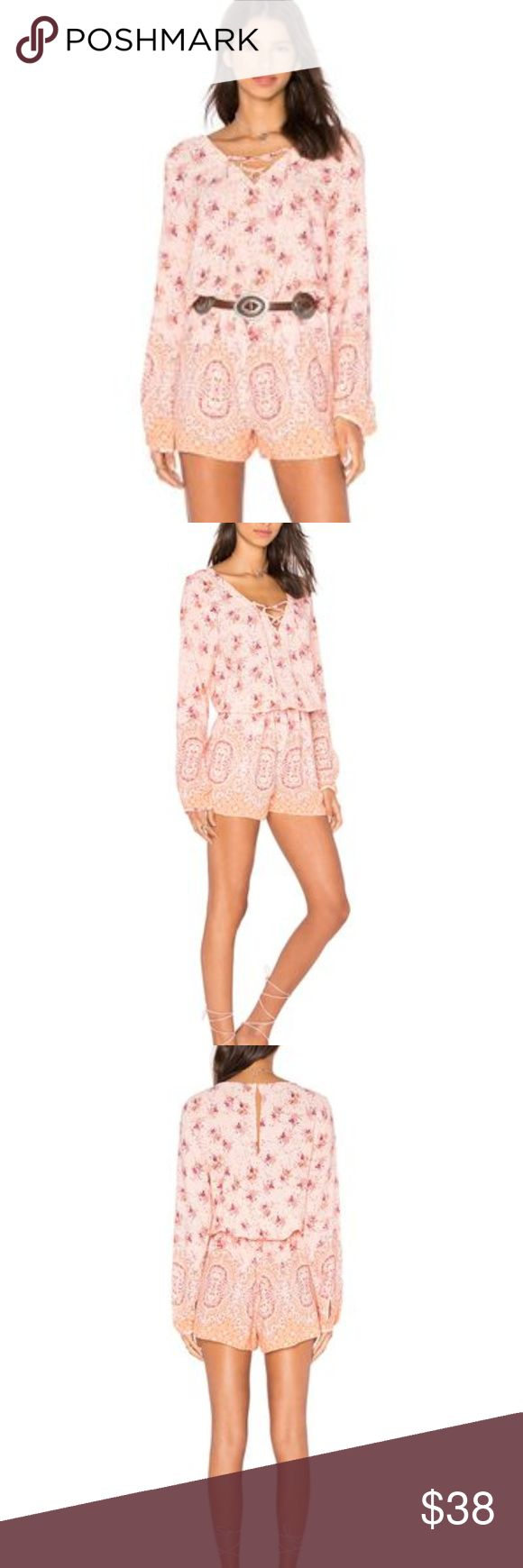 Sanctuary Brown Eyed Girl Romper 100% viscose Fits true to size, order your normal size V-neck, lace-up front, long sleeves, button cuffs. Floral print, elasticized waist, side slit pockets. Back button keyhole closure, pull-on style  size Medium. Sanctuary Pants Jumpsuits & Rompers