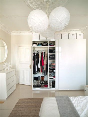 Wardrobe with storage boxes above, hanging storage and shelves