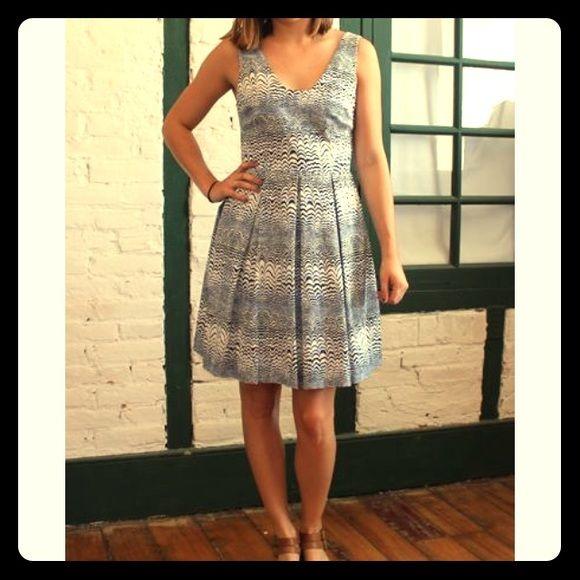 NWT Trina Turk Dress with wave print Pretty wave print from Trina Turk. NWT. Size 8. Fun back detail. Trina Turk Dresses