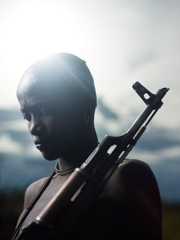 Olochia shot an invading Hyena near their home with their family's Kalashnikov rifle. Joey Lawrence