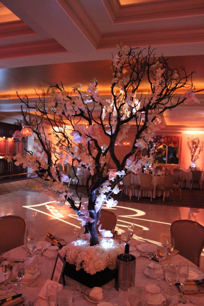 Tree centerpieces are becoming popular, and this is a great example of when it is executed correctly.