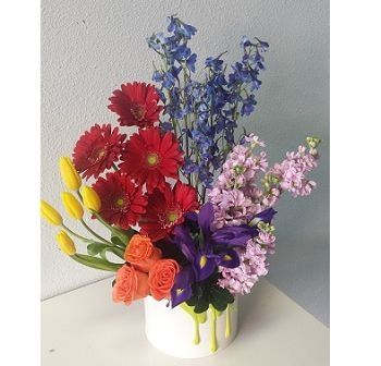 A colorful garden full of the best flowers in the shop. Delivered in a ceramic paint can keepsake container.  Enchanted Florist Las Vegas #valentinesday