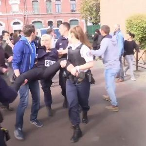 Topless protesters wear Putin and Trump masks as they demonstrate at the voting station where Marine #news #alternativenews