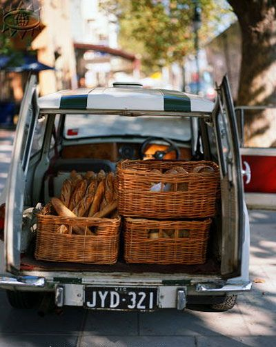 Classic mini clubman carrying baguette's and other assorted breads.