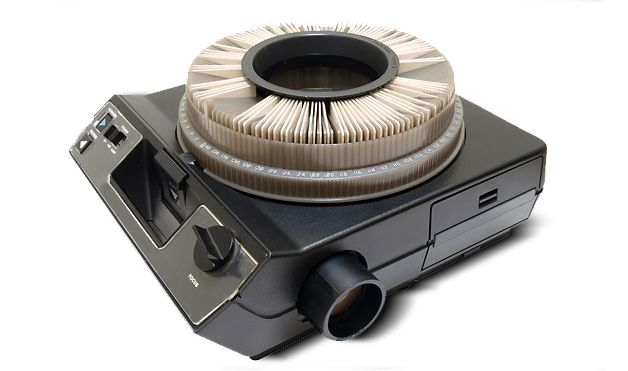 Carousel slide projector. K-chunk, K-chunk, Click...I can remember that sound!   So many of my childhood pics were on slides!