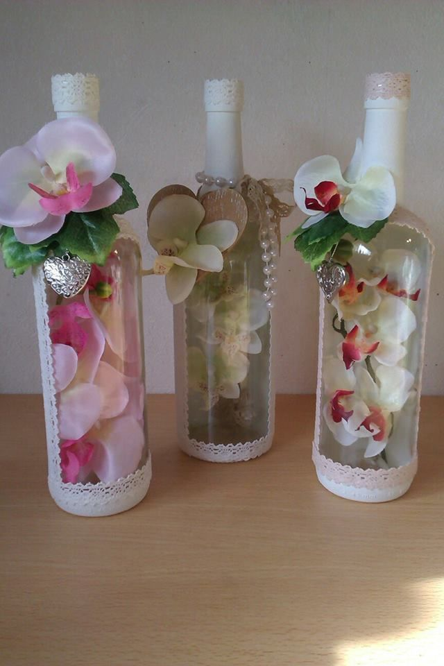 Fill a painted wine bottle with silk flowers and decorate with wine bottle charms