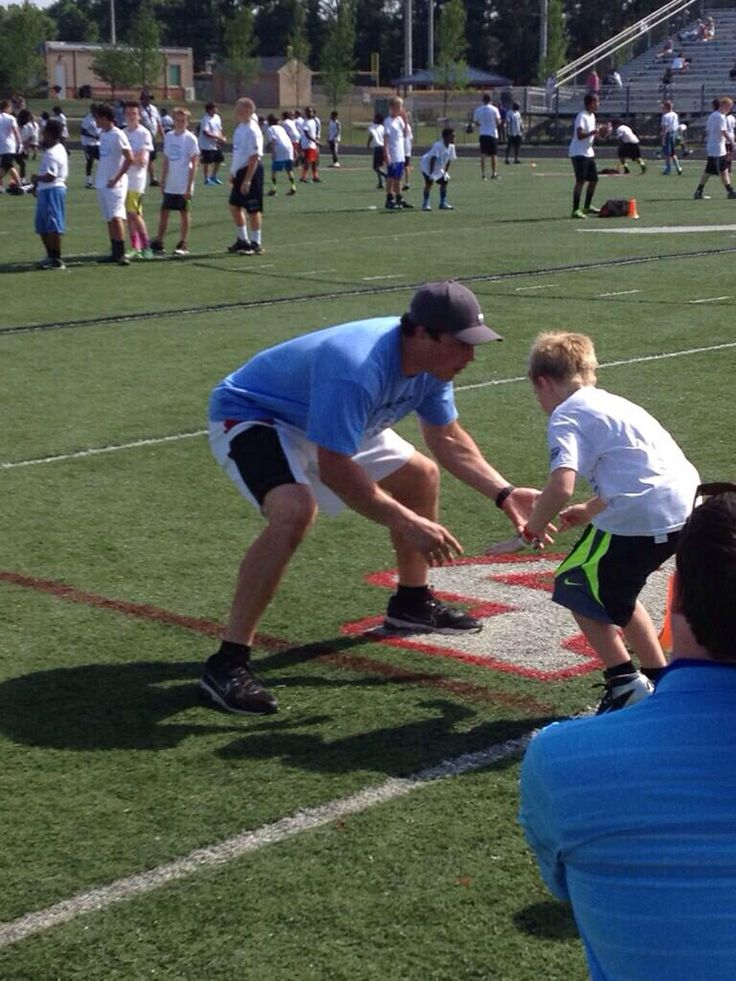 Luke Kuechly at Steve Smith's football camp this morning at Ardrey Kell High School