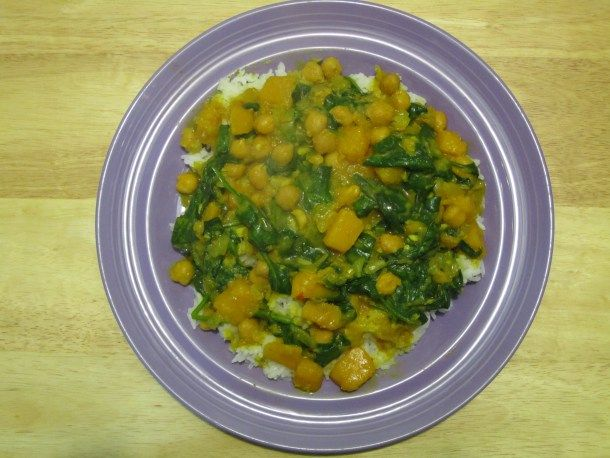 Yellow Curry w/ Butternut Squash, Spinach & Chickpeas; image by The Opinioness - started with onion, garlic and ginger with olive oil, added equal parts cinnamon, curry powder, garam masala, cayenne, cumin and coriander, about 2 tsp salt. added squash, then chickpeas with about 2 cups stock. simmered until squash was tender, added chard. turned out realllyyy well! will make this again for sure