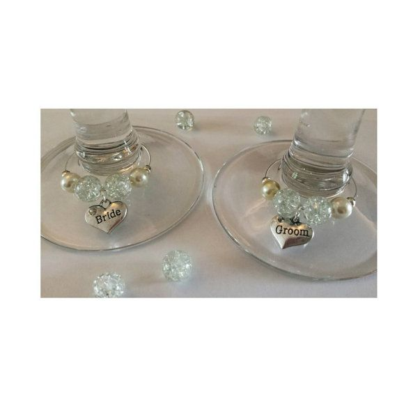 Check out this item in my Etsy shop https://www.etsy.com/uk/listing/243168407/top-table-wine-glass-charms-bride-and