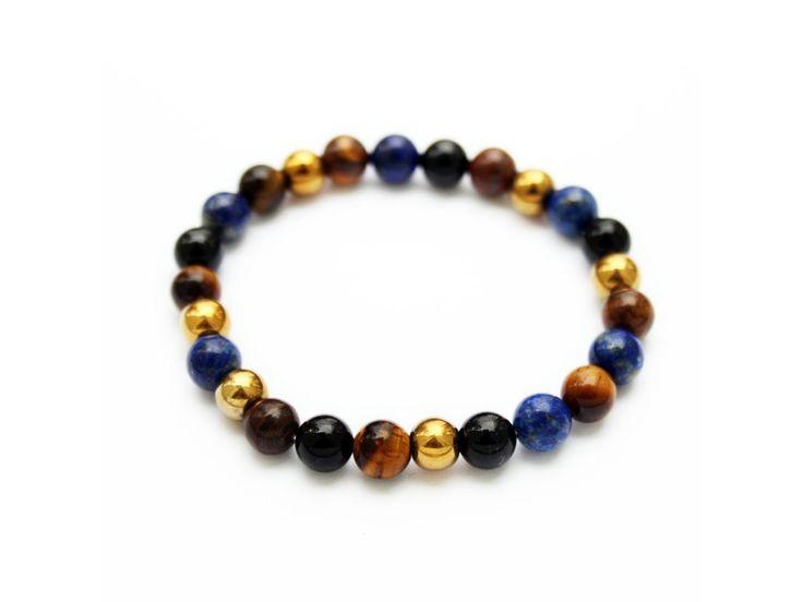 Dámskýbuddha náramek z lapis lazuli,hematitu, tygřího oka a onyxu   Velikost korálků 8 mm.  Dodáván v dárkové krabičce.