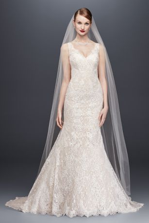 Head-to-toe lace is the star of this trumpet wedding dress. Corded lace appliques lend stunning contrast, and scalloped lace trims the skirt and neckline. More than 40 pieces of beaded lace appliques make this dress a wearable work of art.  Oleg Cassini, exclusively at David's Bridal  Polyester  Chapel train  Back zipper; fully lined  Dry clean  Imported  Also available in plus size, petite, extra length, and plus size extra length