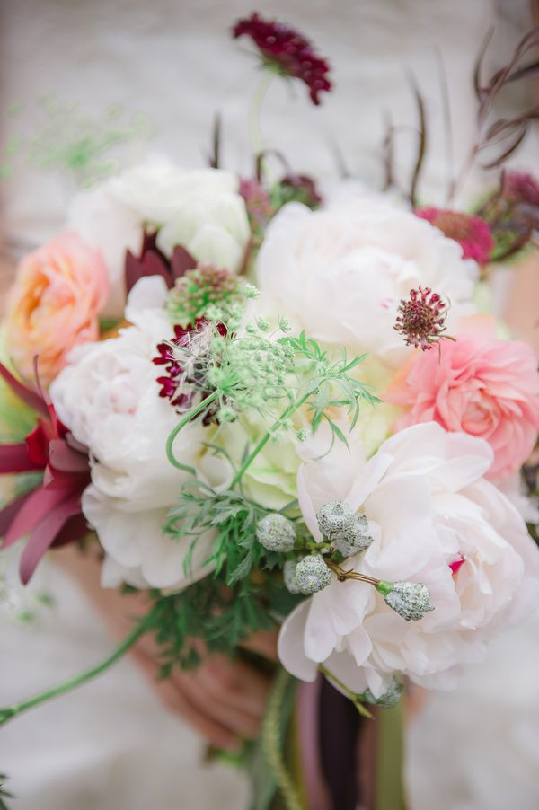 mixed bouquet with white peonies, photo by Julie Paisley http://ruffledblog.com/cotton-field-winter-wedding-ideas #flowers #bouquets #wedding
