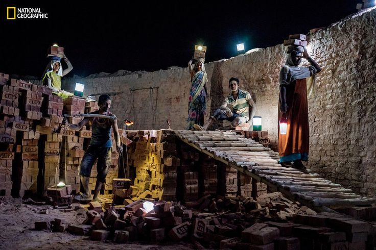 At a brick kiln in India's rural state of Uttar Pradesh, workers use solar lanterns to illuminate their paths.