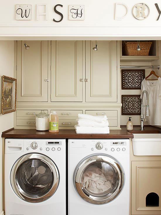 The traditional setup in nearly every room is to leave some space between cabinet and countertop. This laundry room makes use of that usually discarded area with slim storage cabinets, perfect for smaller laundry care items. Decorative drawer pulls add interesting accents, and the clever pet door under the sink supplies a hiding spot for the family's furry friend./