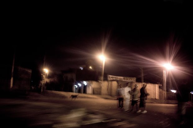 A group of drug dealers in the streets of the villa (Lomas de Zamora, southern outskirts of Buenos Aires; April 2015). The photo was taken by night from inside a running car.