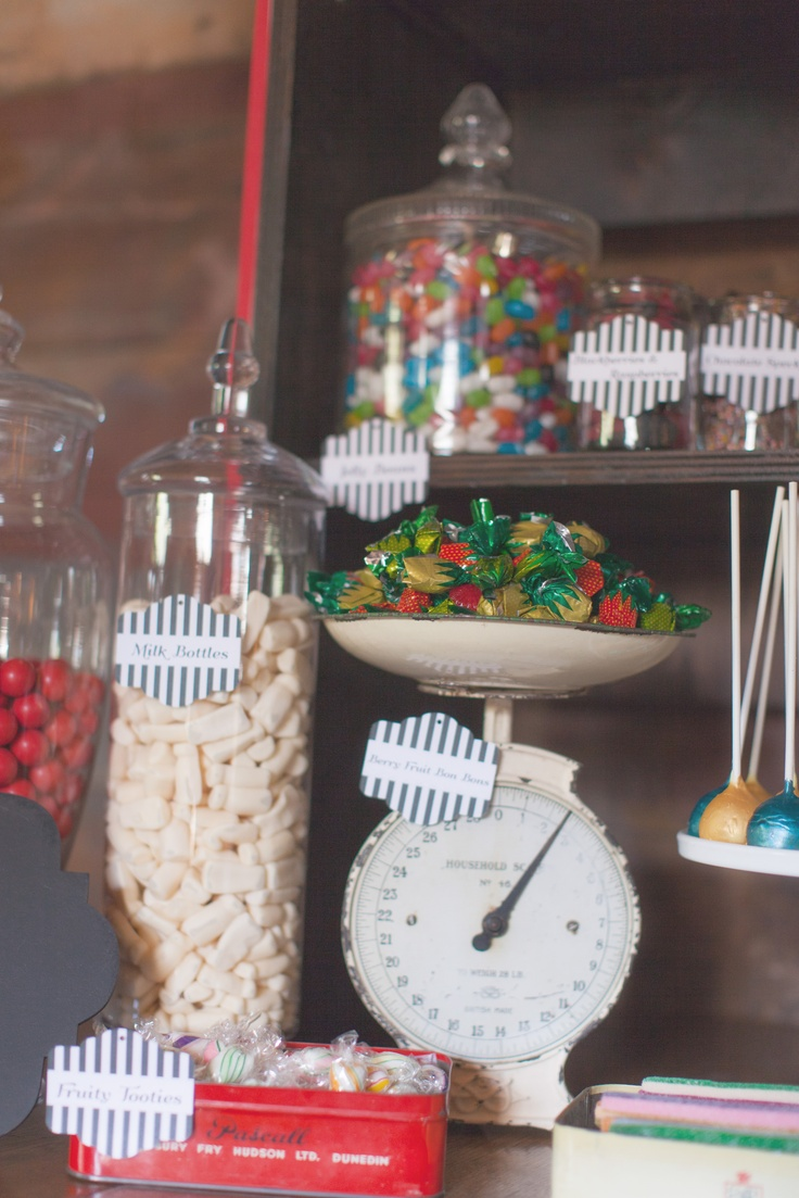 Vintage & Pretty antique salter scales, candy jars and tins used to display old fashioned sweets.    Photography by Candy Capco
