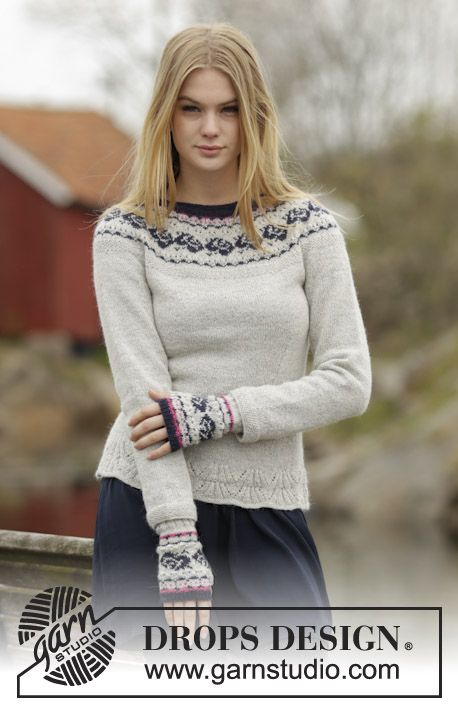 Knitted DROPS jumper with round yoke and rose pattern in Alpaca or Flora. Size: S - XXXL. Free pattern by DROPS Design.