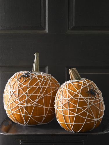 Tangled Web  Cotton kitchen twine and few plastic spiders transform pumpkins from bright and cheery to creepy-crawly in a matter of minutes.    Read more: Easy Pumpkin Decorating Ideas – Unique Pumpkin Decorating Ideas at WomansDay.com - Woman's Day