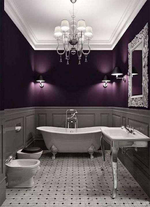 The aubergine and the chandelier just amp up the class in this bathroom - looks like a perfect place to relax.
