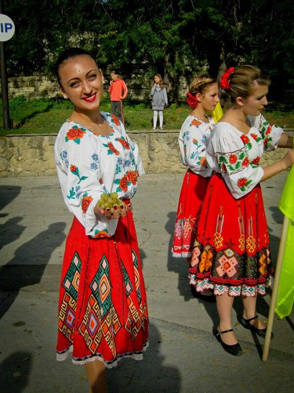 Ladies in traditional dress getting ready for a festival parade in Moldova.