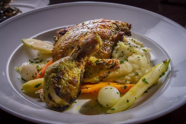 Sunday Roast Chicken ($26) is larded with bacon and served on horseradish mashed potatoes, vegetables and mustard-bacon jus at Cavalier Pub in SF
