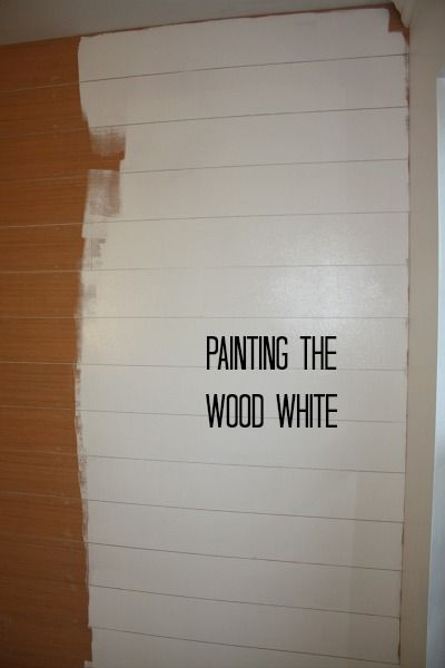 create the shiplap look: painting the wood white