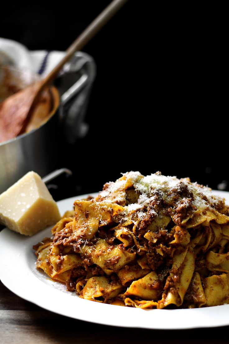 Caramelized Garlic Rosemary Pancetta Beef Pork Porcini Ragu with Tagliatelle Pasta, Parmigiano and Bay Leaves