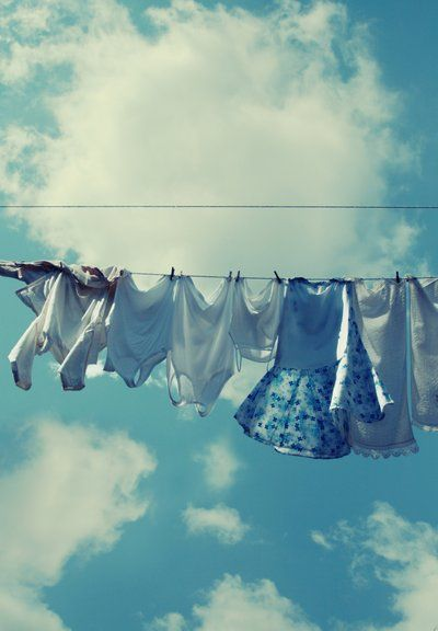 shades of blue cotton drying on the line against a perfect sky
