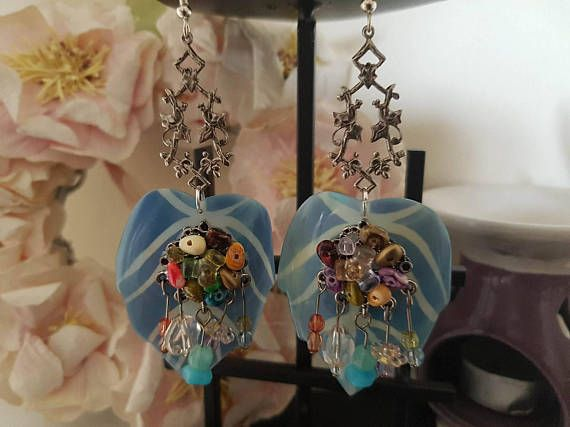 Check out this item in my Etsy shop https://www.etsy.com/uk/listing/511328811/mismatched-jewelled-shell-leaf-earrings
