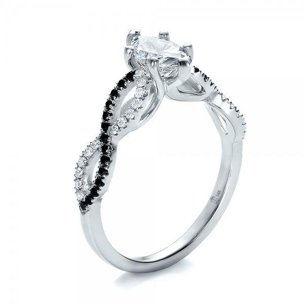 Simple Custom Black and White Diamond Engagement Ring looks like the infinity symbol love it