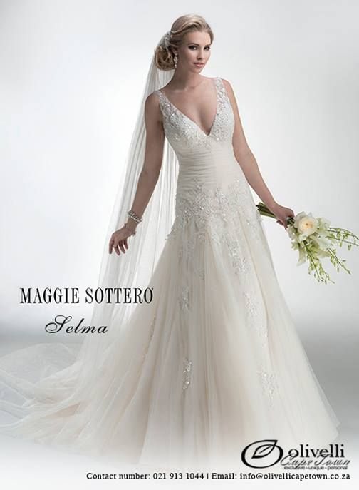 Beaded embroidered lace on tulle adorns this demure drop-waist A-line gown, featuring detachable front modesty panel and detachable lace cap-sleeves. Finished with covered buttons and zipper over inner elastic back closure. #OlivelliCT #MaggieSottero #WeddingGowns