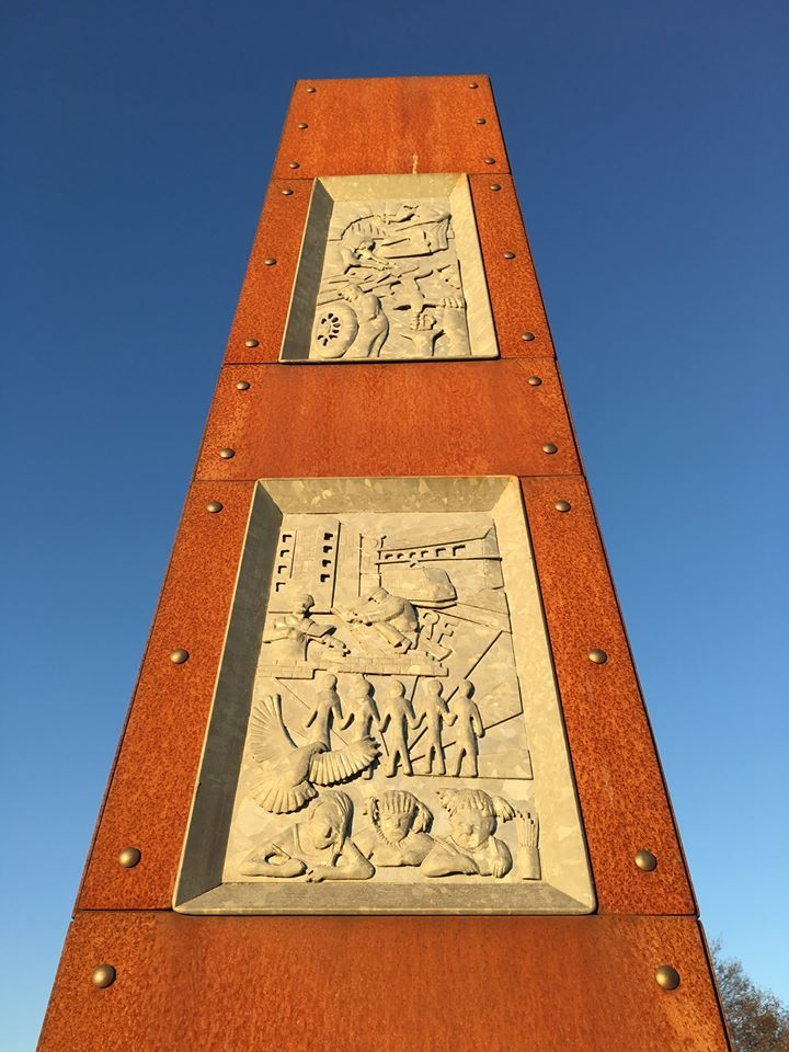 Heritage Chimney sculpture marking the entrance to Bilston town in Wolverhamton metropolitan area.  This piece tells the story of the town from Iron Age to present day. The cor-ten steel gives the piece the warm glow and the galvanise steel provides detail in relief.  Thrussells © 2012