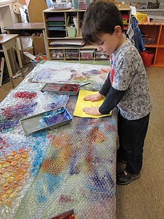 bubble wrap for dinosaur skin- could have the entire paper painted first day, then second day draw a dinosaur on the back- cut it out, glue it to a new paper and create an environment!