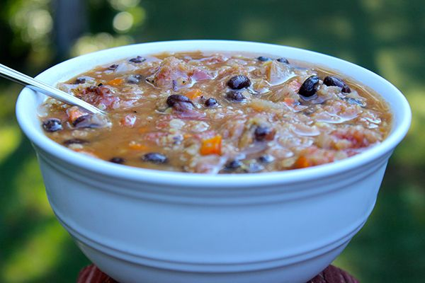 If you've got a lot on your plate this week, consider making a batch of this healthy, spicy soup. It will keep your energy up for hours with its high fiber, high protein mix of black beans and lentils.  #blackbeansoup #lentilsoup