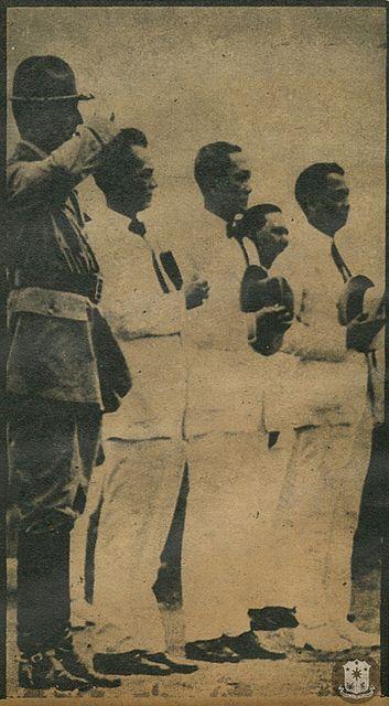 From left, Douglas MacArthur, Manuel L. Quezon, Sergio Osmeña, Manuel Roxas reviewing troops, circa 1920s.