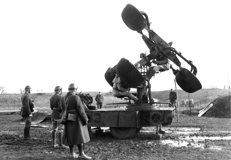 Members of the French Army man an acoustic locator device on January 4, 1940. The device was one of many experimental designs, built to pick up the sound of distant aircraft engines and give their distance and location. The introduction and adoption of radar technology rendered these devices obsolete very quickly.