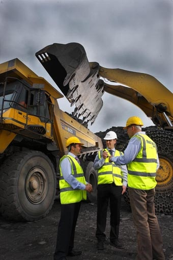 Three Roadstone workers in front of diggers at quarry © David Cantwell Photography