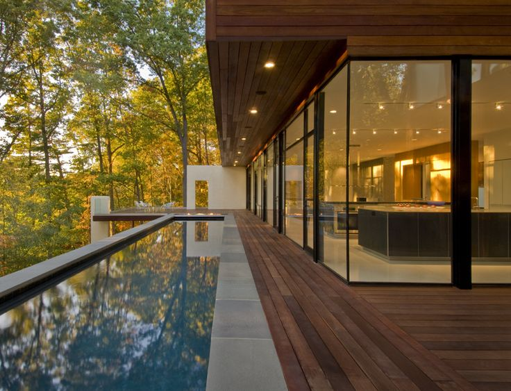Wissioming Residence, Robert Gurney Architect.    This house located in Glen Echo, Maryland is sited on a heavily wooded lot overlooking the Potomac River. Glen Echo stands as a rare enclave of modern houses in suburban Washington, DC. A new swimming pool is suspended twenty feet above grade to further reduce the impact to the steeply sloping site.