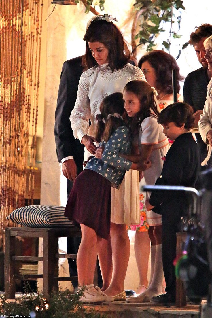 Make new friends: In between takes Holmes' daughter Suri Cruise joined her mother on set and hung out with the young actress playing Caroline Kennedy (above)