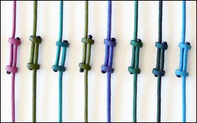 Carol Simmons describes how to made a slider closure with window shade cord and polymer clay sliders.