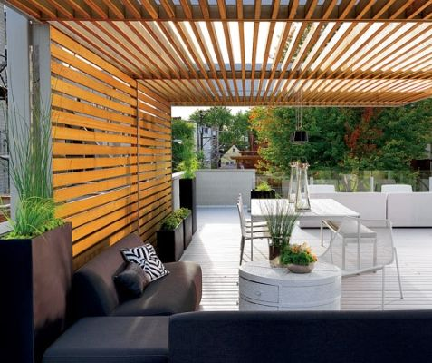 A cedar slat canopy over the terrace atop the garage offers privacy and shade.