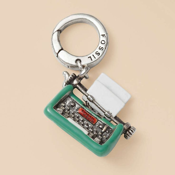 New charms at Fossil. And every writer needs a Typewriter Charm. Must add to my growing list of Fossil wants. :)