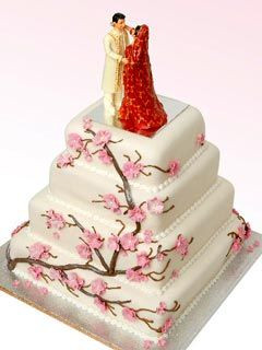Square four tier Indian theme Cherry Blossom wedding cake with pink Cherry Blossom decorative work.