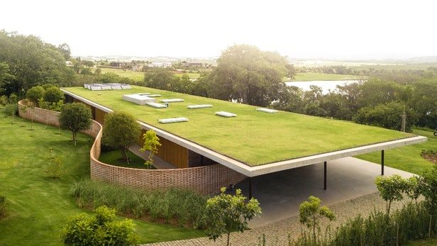 Expansive Green Roofed Home Opens Up To The Brazilian Countryside Green Roof Architecture Grass Roof